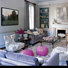 Love pink accents in a living room!