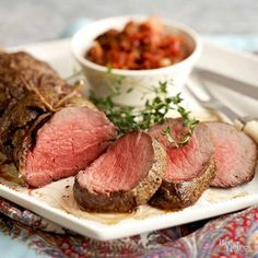 This dinner recipe reveals the secret to making an easy slow-roasted beef tenderloin the best it can be: Start roasting at a low temperature, then switch it to high. Plus, roasting it on a bed of fresh herbs infuses the meat with irresistible fragrances. Slow Roasted Beef Tenderloin, Whole Beef Tenderloin, Cooking Beef Tenderloin, Roast Beef, Cooking Steak, Cooking Bacon, How To Cook Tenderloin, Beef Steaks, Healthy Cooking