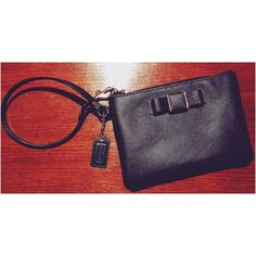 "Coach Wristlet Used a few times! Perfect condition! Black leather. Subtle ""Coach"" branding on tag and hardware surrounding bow! Dimensions 6"" X 4.5"". Zip closure. NO LOW BALL OFFERS! NO TRADES! NO PAYPAL! NO MERCARI!!! Coach Bags Clutches & Wristlets"
