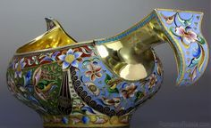 A SUPERB large antique gilded silver and shaded cloisonne enamel kovsh by one of the best Russian enamelers - Maria Semyenova,     of traditional boat shape with hook handle. The exterior of  the bowl is completely covered with elaborate floral designs on richly colored grounds. Made in Moscow between 1908 and 1917.