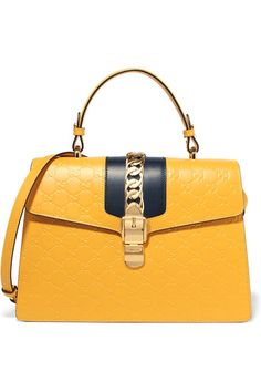 Yellow and black leather (Calf) Clasp-fastening front flap Comes with dust bag…