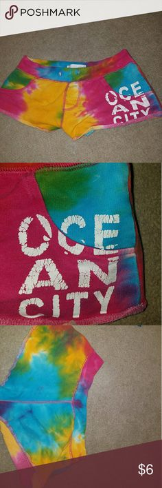 Tie dye Ocean City shorts Worn a few times They are a little short on me and I am a size M, but they do fot my waist Recommended for at home wear considering the shortness of them Good condition, letters are a little cracked due to washing them Shorts