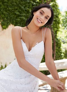 Beautiful, yet fun, this floral lace wedding dress is whimsical and modern. Daisy inspired guipure, textured with floating flowers, drops into a soft lace skirt...