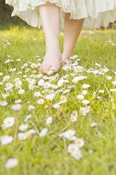 Walking barefoot in the grass and flowers. Aren't daisies the friendliest flowers? I think they are.:)