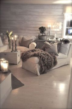 Cosy Shabby Chic! The neutral colours and tall candles create a peaceful atmosphere