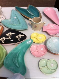 What cool pastel colors for your 1950s retro home!  Great mid-century modern ceramic ashtrays.