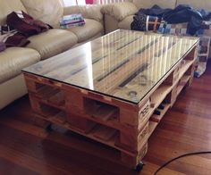 Recycled Pallet Coffee Table With A Recycled Fish Tank Glass Top