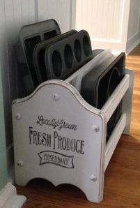 wooden magazine rack repurposed to hold cookie sheets, muffin tins and cake pans....cute idea