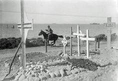 An Anzac courier gallops along the Gallipoli coast to avoid sniping. He is passing by a war cemetary.
