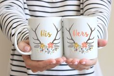 His And Hers Mugs, Set of 2 Mugs, Wedding Mugs, Couple Mugs, Mr & Mrs Mugs, Bride And Groom Mugs, Coffee Cup, Floral Deer Antlers, Spring, UK A marvellous pair of his and hers or mr and mrs mugs with a pretty floral deer antlers design. You also have the option of having Bride and Groom on the mugs instead. The 2 mugs make the perfect love set and have their designs repeated on the front and back of the mugs. This would make a great gift gift for couples, brides and grooms - especially as…
