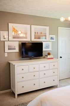 jillgg's good life (for less) | a west michigan style blog: home tour: my master bedroom with Havenly! (gold knobs on ikea dresser, beach photography, photo gallery wall in master bedroom)