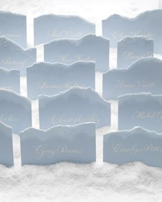 How cool is this idea? (And inexpensive!) Snowbanks of rock salt and frosty mountains fashioned from torn paper dusted with a sprinkling of glistening glitter turn an escort card table into a magical wonderland.