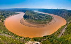 The Yellow River is 3,395 miles long. The Yellow River was a key part in ancient Chinese history.In the north east of China the rivers empties into the Bo Hai which is linked to the Yellow Sea.