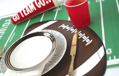 The Die-Cut Football Placemat is a playful addition to your next sports-themed party.