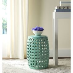 Incredibly versatile, the Lacey indoor-outdoor garden stool in light blue adds a feminine touch to transitional spaces as a seat or side table.