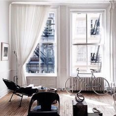Beautiful sheer drapery tied back in this apartment's living room. soft and flowing. interior design ideas ~ home decor ~ beautiful window treatments ~ dream homes Decoration Inspiration, Interior Inspiration, Interior Architecture, Interior And Exterior, Living Room Decor, Living Spaces, Sweet Home, Home And Deco, Dream Rooms