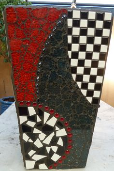 I helped my sister make this fabulous pot. She used tiles, glass gems, TG, Vitreous glass tiles and more.