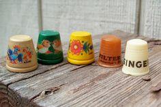 Vintage thimbles Anri Singer Filter Queen wood plastic celluloid bakelite. $12.00, via Etsy.