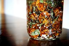 dehydrated cherry tomatoes in oil with spices...dehydrate the tomatoes to dry but not hard as a rock. pack into jar, add dried garlic, onion and basil (I dehydrate them so they won't go rancid/have moisture). cover with olive oil. store in fridge and use for pizza, salads. yum!