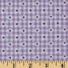 Woven 1/8'' Daisy Gingham Lilac from @fabricdotcom  This woven poly/cotton gingham fabric is ultra comfortable to wear and perfect for blouses, dresses, skirts and kids clothing. In warmer climates, it is also appropriate for lightweight pants.  Fabric features printed daisies through out the fabric.