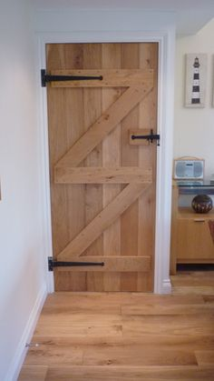 Ledge and Brace Oak Door, Ledged Oak Door.   #LedgedOakDoor #Ledge&Brace  http://www.ukoakdoors.co.uk/internal-doors/internal-doors-by-style/ledge-and-brace-doors/oak-ledge-and-brace-door.html