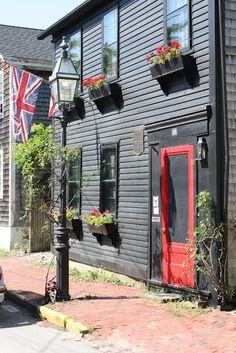 Colonial houses line the streets with flowers
