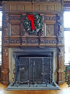 Elaborate antique oak fireplace mantel.