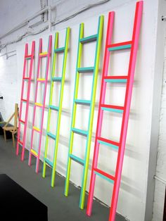DIY: I might need to make a neon/vibrant coloured ladder, great idea for any store display