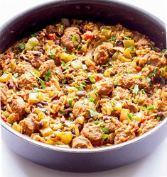 One Pot Wonder Spanish Rice with Chorizo - The Wholesome Dish One Pot Wonder Spanish Rice with Chorizo - A simple recipe with spicy chorizo, Spanish seasoned rice and veggies. And it all comes together in one dish. Seasoned Rice Recipes, Sausage Recipes, Pork Recipes, Mexican Food Recipes, Cooking Recipes, Ethnic Recipes, Spanish Chorizo Recipes, Recipes With Spanish Rice, Chirizo Recipes