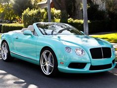 Tiffany blue Bentley. Nothing better than drivin around with the car top down!