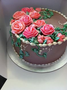 Vintage flower birthday cake--these always look so much better to me than fondant. Fondant makes beautiful cakes, but doesn't look delicious like a pile of icing roses!