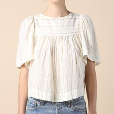 The Isabel Marant Sara Top is a short-sleeve swing top. Made of cotton, it features a jewel neck, gathered shoulder yoke at front and back and button-and-loop c