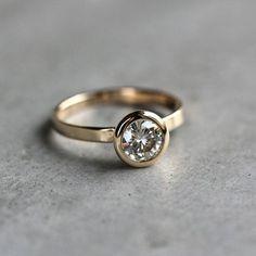 This sparkling 14k gold moissanite ring: