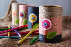 Turn cardboard inner tubes into yarn-wrapped pencil holders.