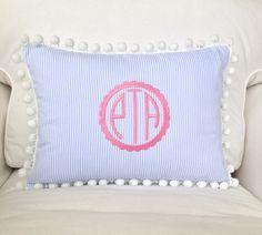A personal favorite from my Etsy shop https://www.etsy.com/listing/212129204/monogrammed-seersucker-pom-pom-pillow