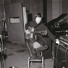 John at the studio during the recording of Revolver, 1966.