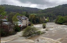 The heavy rain has swollen the River Dee in Llangollen in north Wales, turning the river into a torrent    Read more: http://www.dailymail.co.uk/news/article-2136503/Motorist-drowns-car-submerged-swollen-river-38-flood-warnings-issued-England-Wales-wettest-April-EVER.html#ixzz1tYLkvZX3