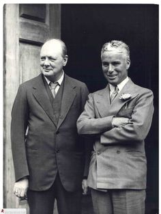 Charlie Chaplin and Winston Churchill posing outside Churchill's home Chartwell, 1931