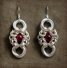 Romanov Earrings in Silver and matte red pearl, via Etsy.