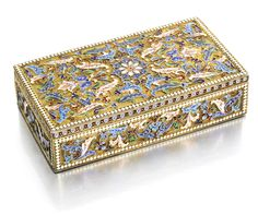 A silver-gilt and cloisonné enamel box, Ivan Saltykov, Moscow, before 1899, enamelled with shaded pink and blue flowers on stippled grounds within white bead borders.