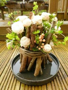 Roses and sticks... Beautiful wedding centerpiece