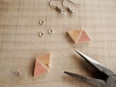 Use the round nose pliers to attach the jump rings and the earring hook