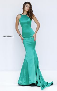 Sleek satin accentuates the curves in captivating style in the Sherri Hill 50044 full-length prom dress with soft trumpet silhouette. The smooth fitting bodice tapers towards the high scoop neckline framed with cut-in shoulders, and shoulder straps frame the open V-back. The dress glides elegantly into the trumpet skirt with pleated inset sweep train.