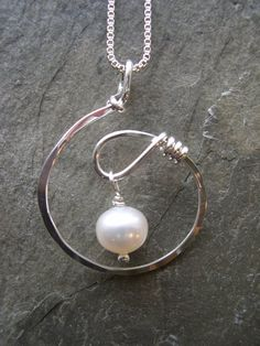 PL:A new twist. A light and lovely design. Sterling silver with freshwater pearl…
