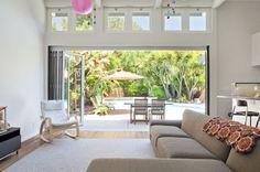 17 Stunning Ways To Use Bi-Folding Doors In Living Rooms
