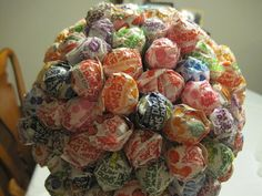 Oh. My. God.  Monochromatic lollipop pomanders for the candy bar.  Like the floral arrangements.  Holy synergy.