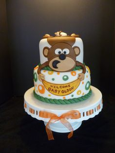 A Monkey for Baby - A baby shower cake made for a party hosted by my daughter-in-law for her friend. 8 inch and 6 inch chocolate WASC with raspberry SMBC filling, chocolate ganache and iced with chocolate buttercream. Covered with MFF. Decorations made from MFF. Thanks for looking!