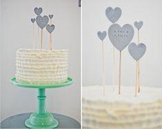 custom heart cake topper, see more here http://www.weddingchicks.com/2013/08/29/cake-toppers/