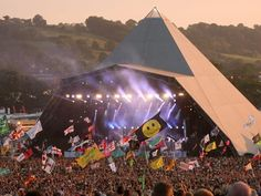 Hidden away in the green fields of Somerset, Glastonbury Festival is the largest and best known of Britain's major music festivals. Overlooked by Glastonbury Tor, a site steeped in legends of King Arthur, this is the place to see both the biggest pop and rock acts and a great selection of up-and-coming performers. The atmosphere is second to none.