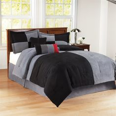 Add color and comfort to your bedroom with the Colorblock Microsuede Comforter Mini Set. Made with black and grey microsuede, this comforter set will be hard to leave in the mornings. The top of comforter is pieced together with chain stitch accents on the seam to create a casual colorblock. The comforter set includes a comforter and two king shams.
